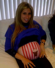 Stacey had her bump painted by make up artist Nibras as one of our baby shower activities